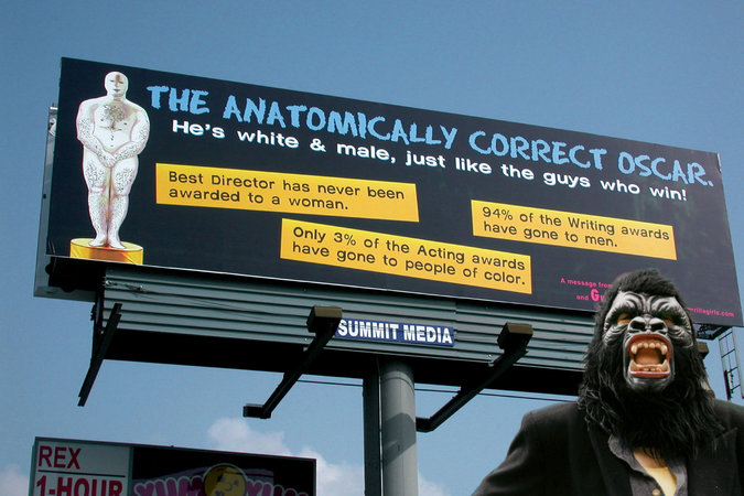 A Guerrilla Girl poses in front of a billboard in 2002 that criticizes the Academy Awards not far from where they are presented in Hollywood. Picture credit to Guerrillagirls.com