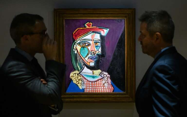 """Picasso's """"Femme au beret et a la robe quadrillee (Marie-Therese Walter)"""" displayed during an auction on February 2018. 