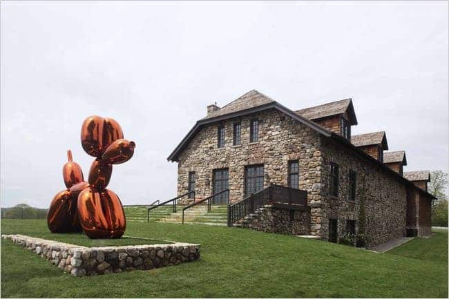 """""""Balloon Dog,"""" by Jeff Koons, part of Peter Brant's collection at the museum his foundation runs in Greenwich, CT with a 200-acre estate. Credit: Todd Eberle   Image source: nytimes.com"""