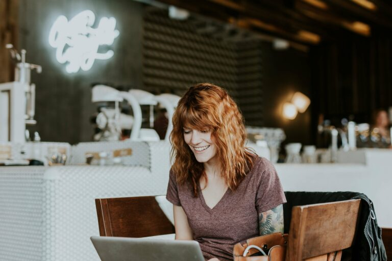 Tattooed woman on laptop by Brooke Cagle @brookecagle on Unsplash