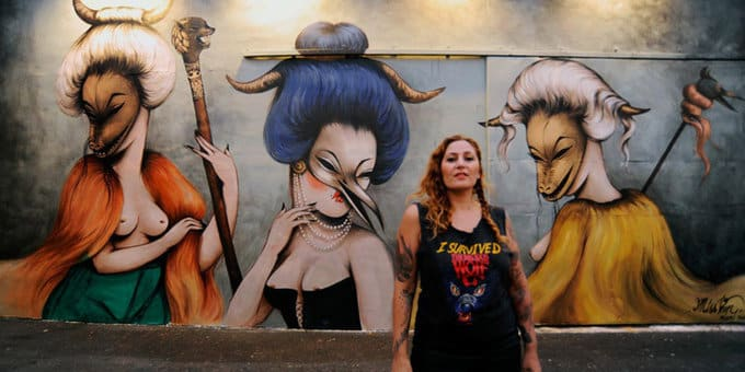Graffiti artist Miss Van in front of her work at Wynwood Walls in Miami