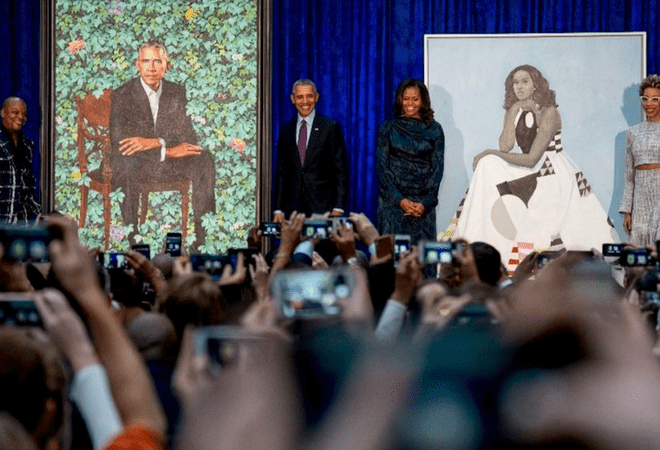 The newly unveiled portraits of former President and First Lady Barack and Michelle Obama and artists Kehinde Wiley and Amy Sherald, at a ceremony at the Smithsonian's National Portrait Gallery. | Image credit: Associated Press, Image source: latimes.com