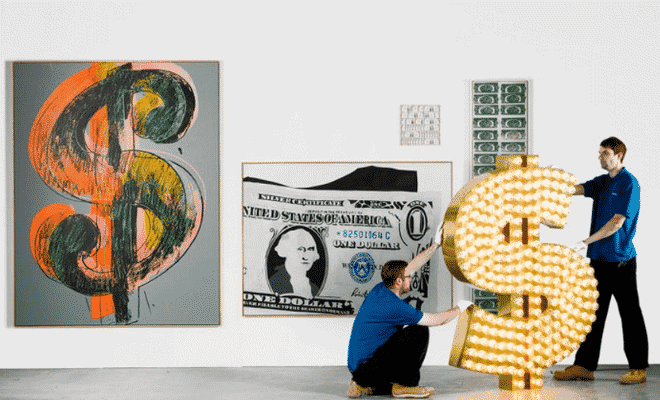 "A-collection-of-21-artworks-that-celebrate-the-power-and-symbolism-of-the-US-dollar-went-on-sale-at-Sothebys-on-1-July-2015-—-including-Tim-Noble-and-Sue-Webster's-sculpture-""""-2001.-660x400"