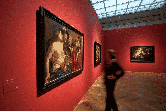 """A visitor viewing exhibition """"Caravaggio in Holland"""" at Städel Museum in Frankfurt am Main in Germany  Image source staedelmuseum.de"""