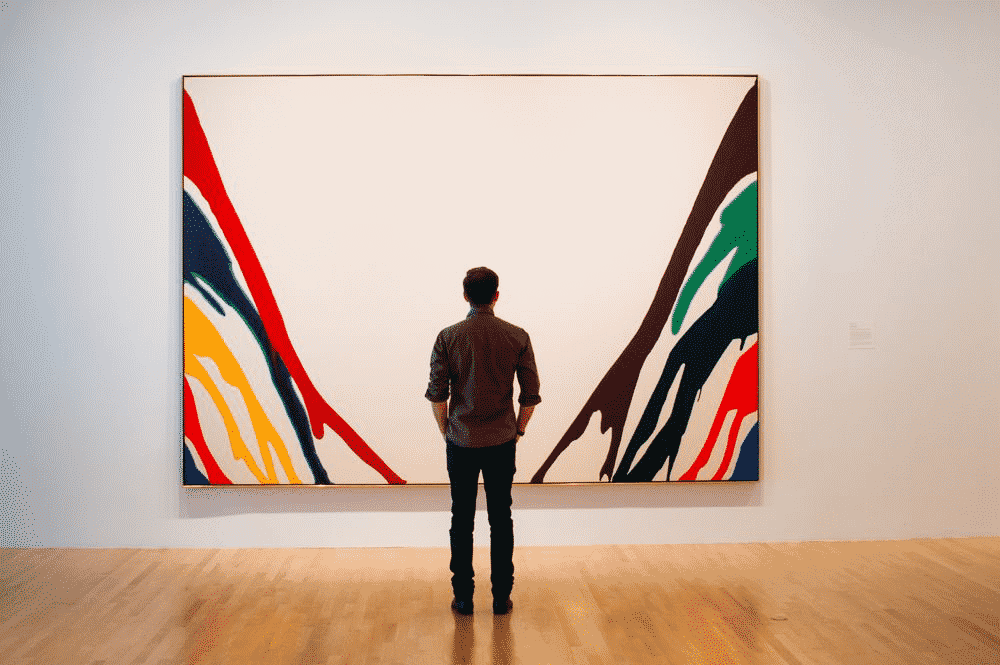 Museum visitor viewing painting by Morris Louis  Image source pinterest.co.uk